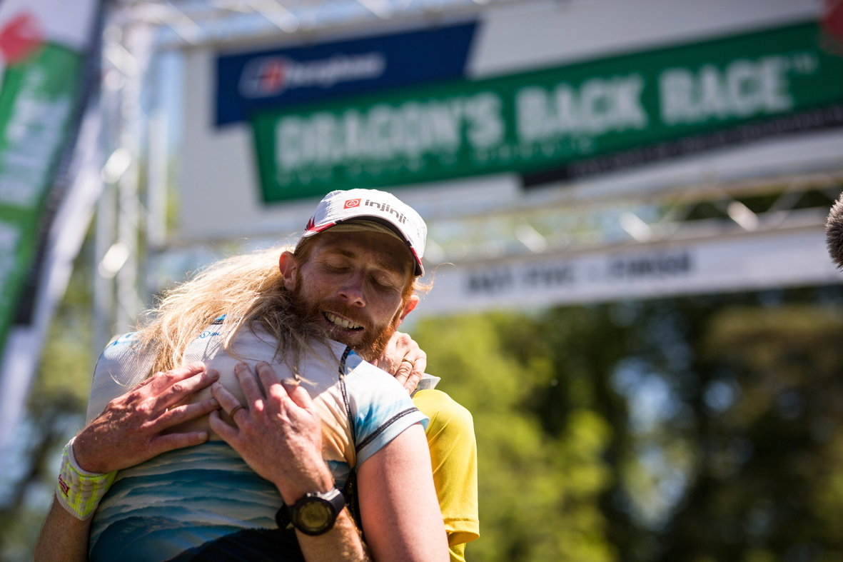 Marcus Scotney embraced by wife Jen after winning the 2017 Berghaus Dragon's Back Race, 141 kb