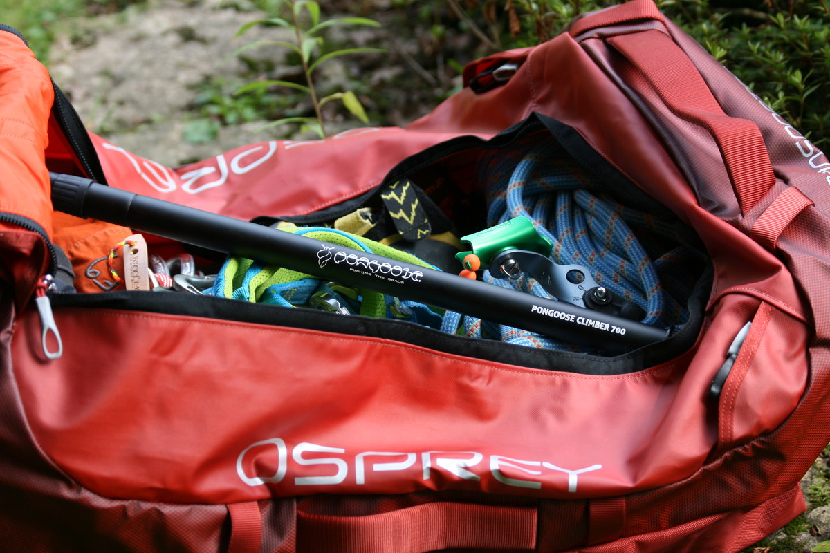 Pongoose Climber 700 clipstick with removable head unit packed inside red Osprey Transporter 130 duffel bag image