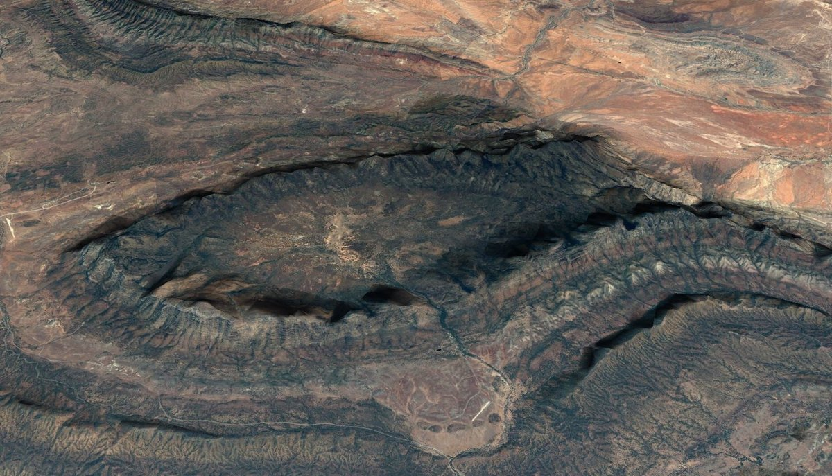 A quick peek from Google Earth showing the bowl-shaped layers of quartzite of which Moonarie is formed. , 205 kb