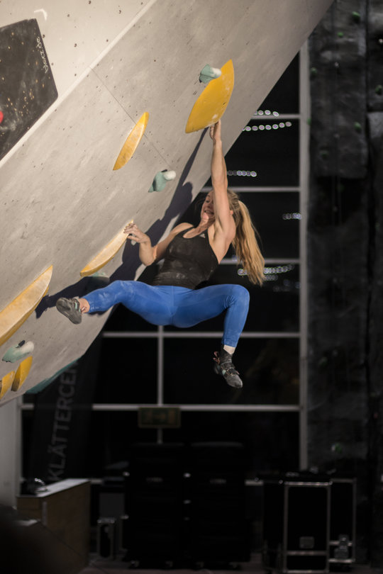 Shauna Coxsey working one of the problems at the Legends Only practice session, 78 kb